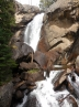 Ouzel Falls from top to bottom; it turns a right angle behind that rock
