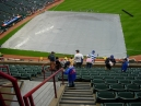 Note the puddle over the home plate area on top of the tarp