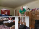 Dad makes himself useful assembling 4 sets of bookshelves
