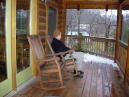 Whew!  Back home at the cabin.  Enjoying the view of the valley from our porch.  Dressed appropriately Larry was very toasty.