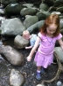 Finding rocks to throw in the water.