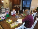 a pre-school bus pickup board game with Mom; Sarah left early for a pre-schoolday meeting